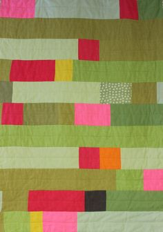 Lap quilt made from linen patches. This would be really great in corduroy, too.
