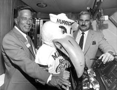UM mascot, Sebastian the Ibis, poses with head football coach Howard Schnellenberger and Don Works (1981). | Florida Memory