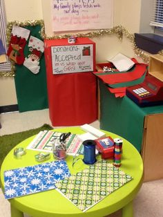 Dramatic play - gift wrapping station. Writing element with gift tags and cards. Dollar tree: boxes, bows, ribbon, decorations, paper, gift tags, cards.