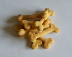 Dog Treat - Cheesy Woof Bones.  The original Charlie & Derek dog treat, these home made dog biscuits are excellent for training because they can be easily snapped into 3 or 4 pieces. As they are made using cornmeal, they have a lovely yellow appearance and a super shape too.