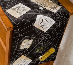 Transform a store bought table runner into a spooky one with Halloween images and Photo Transfer.