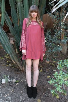 Details The Cara Forever Dress is the perfect bohemian dress featuring delicate tribal embroidery, crochet trim, long billowy bell sleeves with drawstring ties, and button back keyhole. Lined. - Fabri