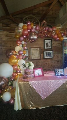 Bridal organic arch with rose gold balloons