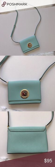 """Kate Spade Newberry Lane Sally Leather Crossbody Gorgeous for spring!  Kate Spade Newberry Lane Sally Leather Crossbody.  Blue Hydrangea Saffiano Leather Colorway.  Mini Turnlock Crossbody with 14kt light gold plated hardware.  EUC - no stains, holes, snags.  Does have a scratch on Turnlock close.  See photos.  Authentic.  Purchased at KS store in King Of Prussia.  Interior slip pocket.  4.9""""h x 7.4""""w x 1.1""""d 22"""" Drop.  Strap is adjustable - 5 holes to adjust.  No trades - questions welcome…"""