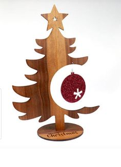 Wooden Christmas DIY Tree with Acrylic Ornament Looking for a new Christmas application to run? Wooden Xmas Trees, Wooden Christmas Decorations, Christmas Wood Crafts, Wood Christmas Tree, Wood Ornaments, Christmas Art, Christmas Projects, Christmas Ornaments, Wood Decorations