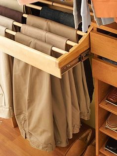 Every closet should have one of these!  A wooden pullout trouser rack.  This rack holds 10 pairs of pants and the dowels lift out!  How neat is that!? Found this on BHG.com.. things-i-want-to-do