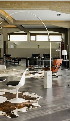 concrete floors / cowhide / arco lamp / Eames lounge chair / Corbusier chairs ...lots of elements that make it a great space