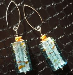 Heavenly blue lampwork glass earrings with natural orange corals - something absolutely different! See at my blog: http://www.greykajewellery.eu/lampwork-glass-earrings-with…/