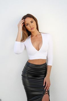 Catherine Paiz wearing a leather pencil skirt with a white crop top long sleeve