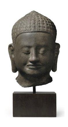 A sandstone head of Jayavarman VII as Buddha -  KHMER, ANGKOR PERIOD, BAYON STYLE, 13TH CENTURY | Christie's