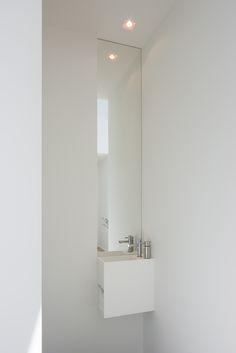 Custom designed toilet lavatory with mirror by architectenburo Anja Vissers. Custom designed toilet lavatory with mirror by architectenburo Anja Vissers.