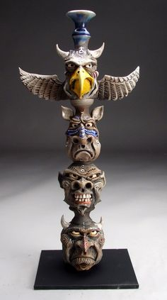 Mitchell Grafton - Totem Pole Ceramic Sculpture  Inspiration for paper mache r clay mask....