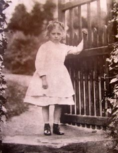 Beatrix Potter at a garden gate about 1871