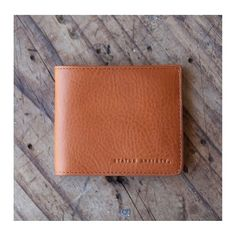 Status Anxiety tan leather wallet.