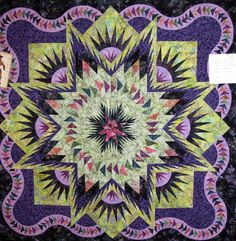 Quilt Name: Glacier Star Made By: Karen Barrett Pattern By: Judy Niemeyer Quilted By: Genevieve Jackson