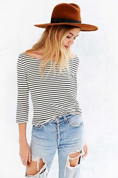 Not really loving the smokey the bear hat, but love the black and white stripes and the distressed jeans.