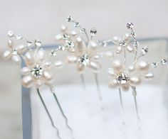 Hair Comes the Bride - Pearl and Rhinestone Flower Hair Pin ~ Camille, $21.00 (http://www.haircomesthebride.com/pearl-and-rhinestone-flower-hair-pin-camille/)