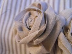DIY Burlap roses.. this would be a great idea for the groom instead of natural flowers