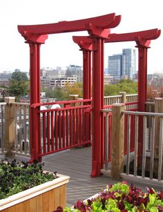 japanese pergola | red stain was applied to create a strong visual accent and works ...