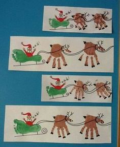 """Santa & his reindeer with hands & feet. My 11 yr old Grandaughter & I made this on a white """"waiters"""" apron. Adorable!"""