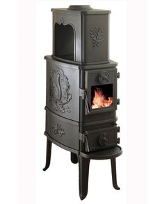 the squirrel-emblazoned, spot-for-a-teakettle wood stove of my dreams! <3