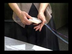 "Tablet weaving instructor Linda Hendrickson demonstrates how to make a continuous warp. This is a segment from the DVD ""Weave A Neckpiece"", a visual companio. Inkle Weaving, Inkle Loom, Card Weaving, Weaving Yarn, Tablet Weaving Patterns, Medieval Crafts, Types Of Weaving, Weaving Techniques, Loom Knitting"