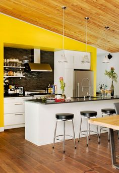 Chalet Bolton-Est by Boom Town | Bold yellow wall in the kitchen
