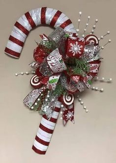 holiday wreaths DIY Christmas Wreaths for Front Door - Party Wowzy Christmas Candy Cane Decorations, Candy Cane Crafts, Holiday Wreaths, Christmas Ornaments, Christmas Wreath With Ornaments, Candy Cane Christmas Tree, Christmas Wreaths For Front Door, Christmas Swags, Wreath Crafts
