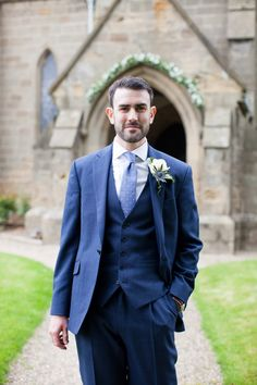 groom in a blue suit