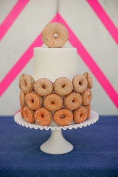 A really fun and unique wedding cake with donuts by modwedding, via Flickr