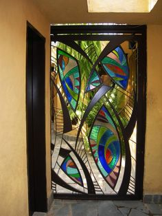 Stained Glass+ Iron by NUZ at Betsy Frank Gallery  #stainedglassdoor #artnuz