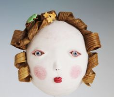 Girl with shield bug jewel by Midori Takaki #ceramic #mask #sculpture