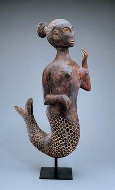 """""""Dona Fish"""" mermaid statue, Ovimbundu peoples, Angola (Photo by Don Cole) circa 1950"""