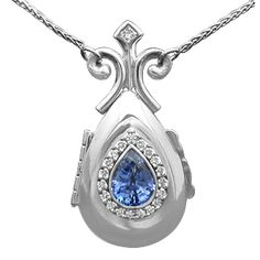 Something Blue Locket - Solid platinum locket custom made to hold 2 pictures. 1.5 ct pear shaped brilliant blue sapphire and 0.20 ctw of diamonds make the jewels come alive.  Price calculator does not include the chain or center stone.