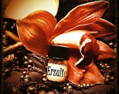 Erzulie Freda Floral Perfume Oil     Use this oil to increase your personal magnetism, and to draw love and prosperity to you.  • 3/4 cup jojoba oil  • 1/2 teaspoon essential oil of rose  • 1/2 teaspoon essential oil of lavender  • 1 teaspoon essential oil of geranium  • 1/4 teaspoon essential oil of ylang-ylang  Mix together and store in a tightly sealed bottle, in a dark place. Wear as a perfume or anoint charms.
