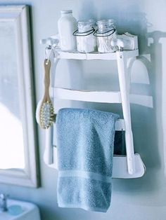 Recycle an old chair into a shelf with towel holder. Cut off chair mid-seat to the length of the shelf you want. Screw on some brakets and hang on the wall