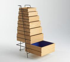 japanese architect keiji ashizawa has designed 'sutoa', a drawer unit made from wooden boxes, for european sales and design agency frama. the minimalist structure is comprised of seven stacked chestnut containers and a steel frame onto which they slid Cool Furniture, Furniture Design, Modular Furniture, Drawer Design, Drawer Unit, Wooden Boxes, Decoration, Home And Living, Home Accessories