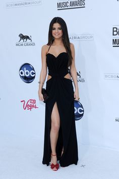 I'll admit that I'm not crazy about the shoes, but I LOVE the dress and LOVE Selena!