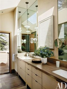 In the master bath, which opens onto a private deck, the sink fittings are by Kallista.
