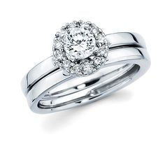 Brides.com: Engagement Rings Under $5K . Platinum and diamond halo ring with round diamond center stone, $3,669, Ostbye