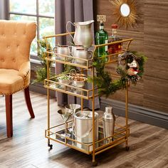 Serve in style with our tiered bar cart. With two clear glass storage shelves and a mirrored bottom shelf that accommodates tall bottles, its wrought iron frame and golden finish give happy hour a luxe look. Diy Home Bar, Home Bar Decor, Bar Cart Decor, Diy Bar, Bars For Home, Plywood Furniture, Bar Furniture, Kitchen Furniture, Furniture Design
