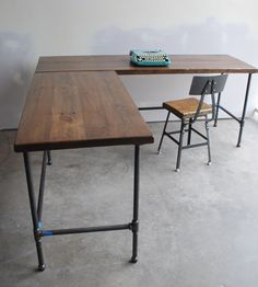 $995 on Etsy. Can be made into standing desk.   L shape desk. Reclaimed wood. Made to order in by UrbanWoodGoods