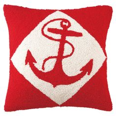 Hand-hooked wool throw pillow with a red anchor motif.   Product: PillowConstruction Material: Wool cover and polyeste...