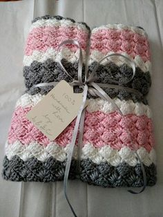 Cuddly Pink, Grey and White striped crochet Afghan! Available in multiple sizes from baby blanket size to full size bed! Want a custom size or different colors? Just message me! I love special orders! I am here to create your new favorite blanket! Makes a great gift! This lovely handmade blanket is made using double crochet clusters in a light spring tones of pink, gray and white stripes. Afghan is handmade with high-quality acrylic yarn that is soft yet durable. Blanket is machine washable…
