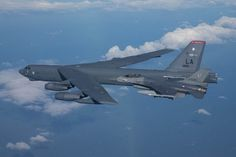 """A U.S. Air Force B-52H Stratofortress from Barksdale Air Force Base, La., and a Koninklijke Luchtmacht (Royal Netherlands Air Force) F-16 fighter jet conduct simulated air intercept maneuvers in support of a U.S. Strategic Command-directed training mission, called """"Polar Growl."""""""