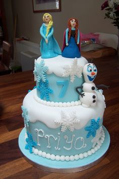 Disney's FROZEN cake with 3 edible characters from the move - Anna, Elsa and Olaf