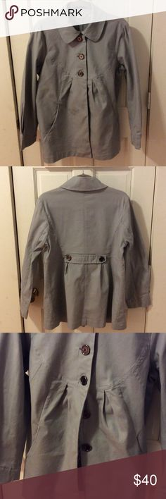 Cute jacket empire waist sz 14 Light weight lt grey jacket with gunmetal color buttons sort of baby doll styling very comfortable is woven material with stretch lots of designer details pleats at the cuffs partial hidden placket see 3rd pic band on the back even has a hook and eye closure at the collar motto Jackets & Coats