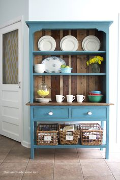 Freshen up a hutch with Benjamin Moore Calypso Blue!  Post has tips on tea-staining/distressing wood furniture. May do this on yellow hutch.
