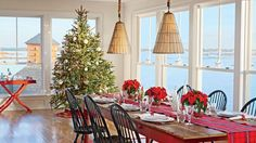 This Stonington, Connecticut, dining room is dressed to impress for the holidays with a simple poinsettia centerpiece, plaid table runner, and gorgeous Christmas tree. Christmas Dining Table, Dining Room Table, Dining Rooms, Home Design, Interior Design, Porches, Coastal Christmas, Christmas Trees, Merry Christmas