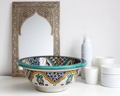 Beautiful handmade washbasin from Morocco. Painted with lovely patterns and colors. Perfect size for the toilet or the guest bathroom.  Color: White and blues Material: Ceramic Size: ø 27 cm (106 inch) Height 11 cm (43 inch)